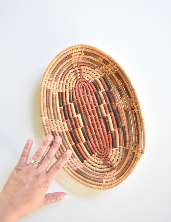 coiled brown oval woven straw rattan wall basket