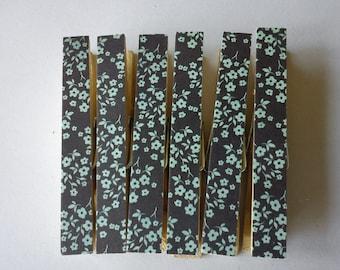 Retro aqua flowers on navy fridge magnets clothespins pegs