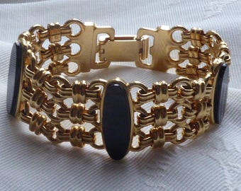 Gold bronze wide bracelet with large Onyx stones