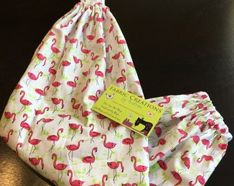 The *Happy Andi* Hanging Grocery Bag Holder Flamingoes, Pink Flamingo, Palm Tree Branches, Flowers, Green