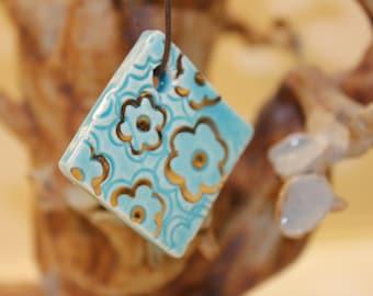 Handmade Ceramic Aqua and Gold Flower Pendant item #T10
