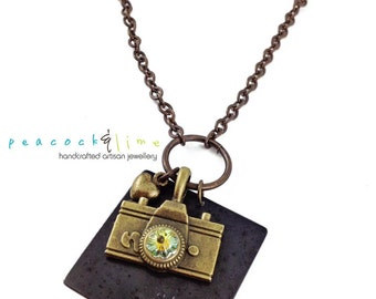 Oh Snap camera pendant necklace // swarovski crystal flower and hand stamped tag // natural brass chain // photographer gift // retro charm