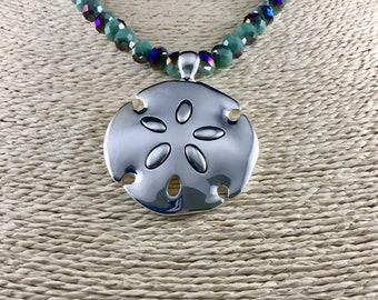 Silver sand dollar pendant