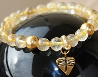 Rutilated quartz beaded bracelet with charm