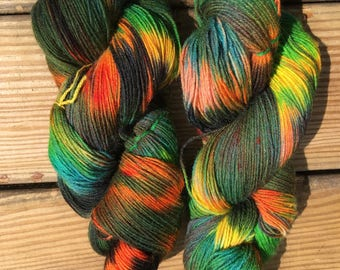 A squawk in the jungle-hand dyed superwash wool sock yarn
