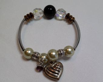 Bracelet with shell beadand silver tubes and hearts, charms  dangles