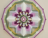 Falltime Flowering, 18 inch, 12-sided yarn mandala, by Inga Savage