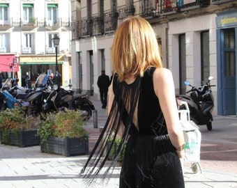 Woman's jumpsuit in velvet and fringes.