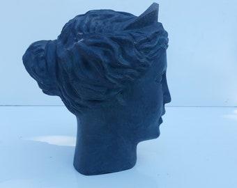 Vintage Female Head Metal Sculpture .