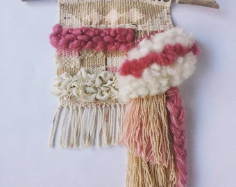"""Woven Wall Hanging // pastel weaving with fringe and braids. Pink, gold, cream, and white. Textured, art yarn, linen """"Soft Offering"""""""