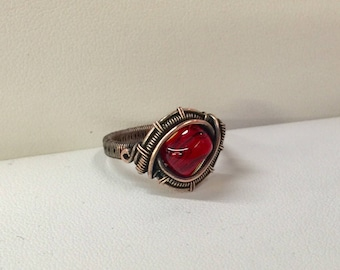 Copper wire wrapped ring with Red glass bead