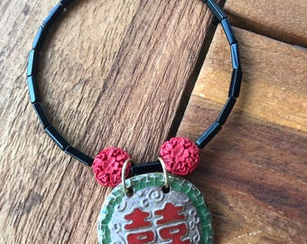 Black and red beaded choker with Asian pendant