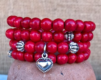 Red boho stacker set of 4 stretch bracelets. Four stacking bracelets in red turquoise with puff heart charm. Valentine loves red.