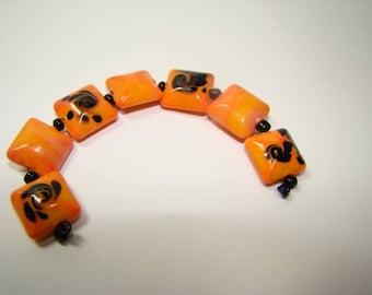Destashing Orange and Black Lentil Lampwork Beads 7pcs Fun Design!
