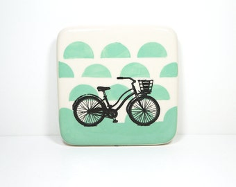 tile with a lady's bike on blue green semicircles, made to order.
