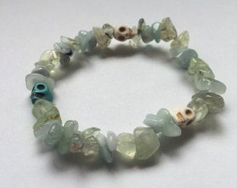 Prehnite and aquamarine bracelet with skull beads