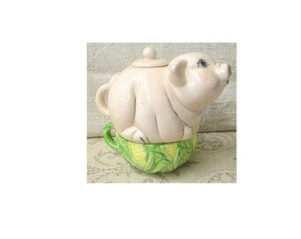 Teapot is a 3 piece pig teapot with cover and cup in bisque for you to finish