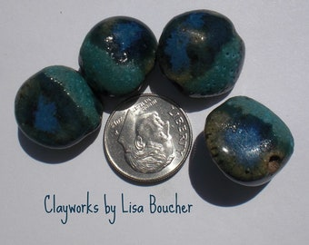 Four Turquoise and Blue Stoneware Coin Pebble Beads