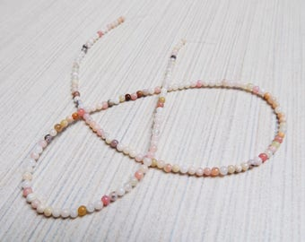 Teeny Pink Coral beads