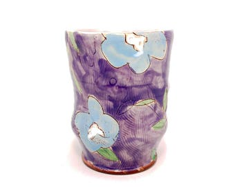Purple Puffy Floral Earthenware Tumbler. Wheel thrown and altered, food safe cup, made by Kaitlyn Brennan/ Brennan pottery