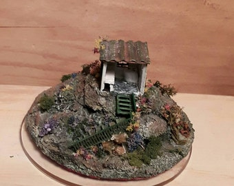 Miniature house 144 scale in acrilic dome