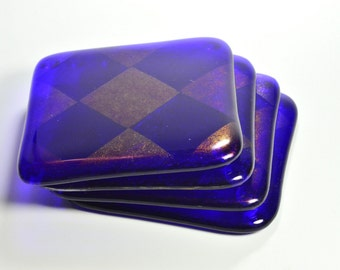 Set of 4 fused glass coasters. Deep Royal Blue with iridescent harlequin design. Perfect house warming gift, or home decor.