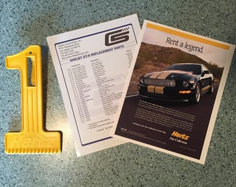 Hertz Shelby Ford Mustang rent a racer promo page 8X10 Shelby Hertz GT-H car part list Ice scraper from the time it was rented & sold