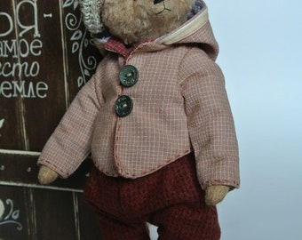 Teddy Bear Martin. Made of viscose. Inside the sawdust and granulate