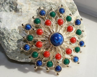 Sarah Coventry Signed Vintage Carnival Brooch.  Red, green and blue pastic cabochons with gold tone setting.  Domed design.