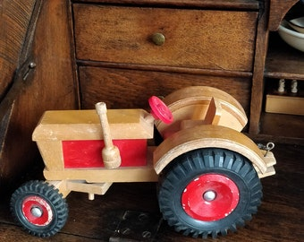 Vintage wooden tractor with rubber wheels and working handlebars