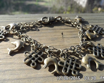 Antique Brass dolphin and celtic knot braclet with lobster clasp