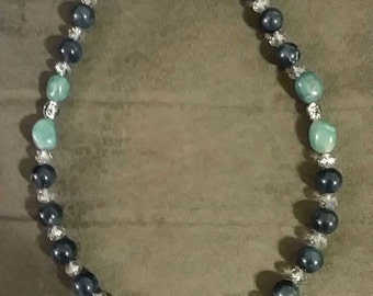 The Blues - Beaded necklace with mother of Pearl center bead, acrylic beads and a toggle clasp.