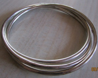 Three Interlocked Sterling Silver Bangle Bracelets