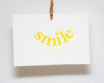 Letterpress woodcut typography, smile, inspirational quote, cheerful yellow, hand printed wall art