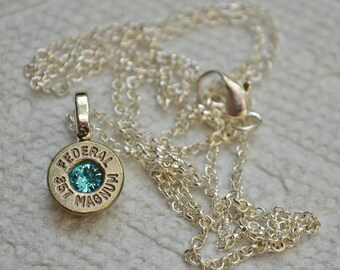 Bullet Necklace.....Nickel silver Federal .357 magnum pendant necklace with an Aqua  Swarovski crystal......Lot 442