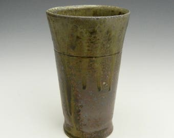 Wood fired cup with natural ash glaze