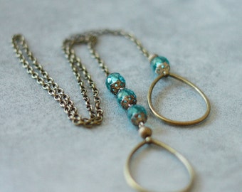 Tie necklace mottled blue beads, silver Sterling and bronze