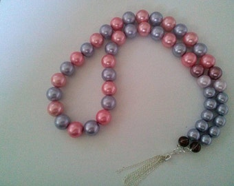 Oversized Pearl Necklace with tassel.