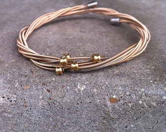 Recycled Guitar Strings - Restored Guitar String Salmon Color SLIM Bracelet