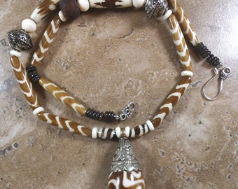 Batik brown and white dyed bone African Necklace with Tibetan silver and focal bead from Nepal - AN16