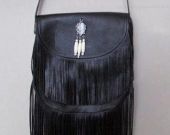Cross body black leather bag with double fringe