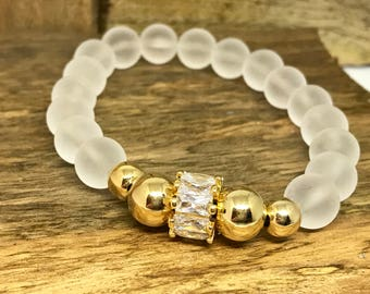 Glass White Beaded Bracelet with gold field beads and some bling.