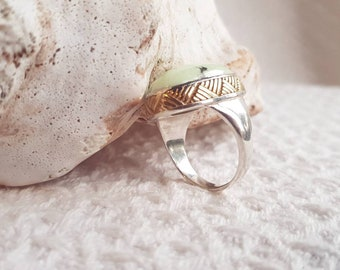 Mint green silver and gold ring. Mint toned chrysophase stone set lovingly in sterling silver embelished with Maori Harakeke whakairo.