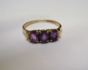 three stone amethyst ring in 9k gold, size 6.5