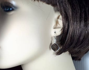 Faceted smoky quartz earrings set in 92.5 sterling silver