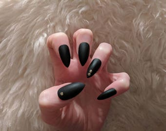 Sassy classy matte black stiletto false nails with gold accents hand painted and made to order