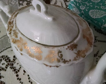 Beautiful, delicate white teapot with gold trim/vintage