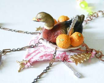 """Necklace: """" Medallion of duck in orange sauce on tablecloth of Christmas """""""