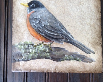 Robin painting on tile