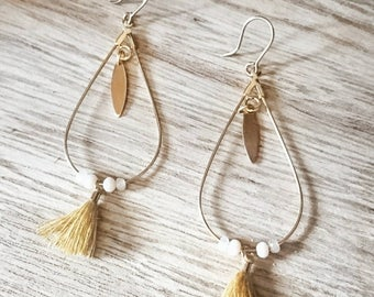 Drop earrings gold, mustard, and Pearl.